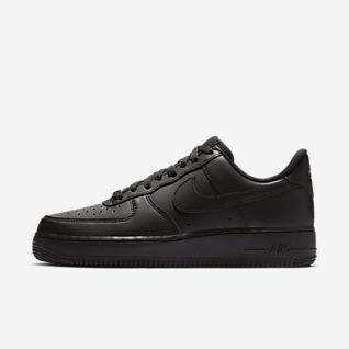 Schwarz Air Force 1 Low Top Schuhe. Nike AT
