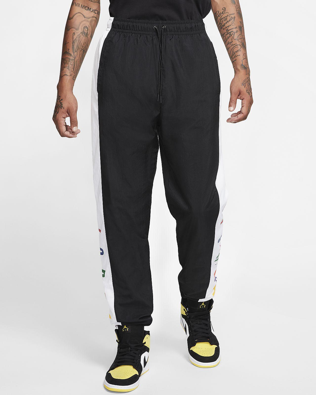 Vævede Nike træningsbukser til mænd. Nike DK