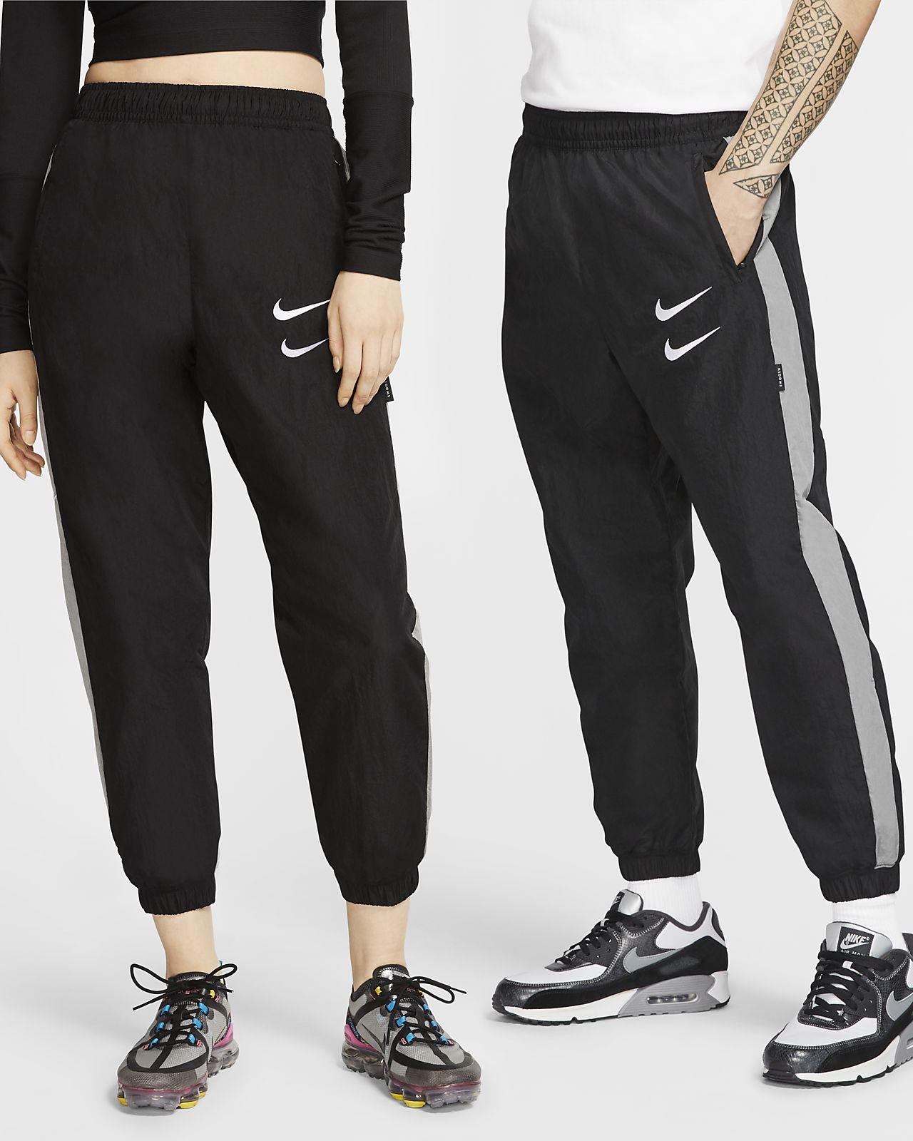 Byxor i vävt material Nike Sportswear Swoosh