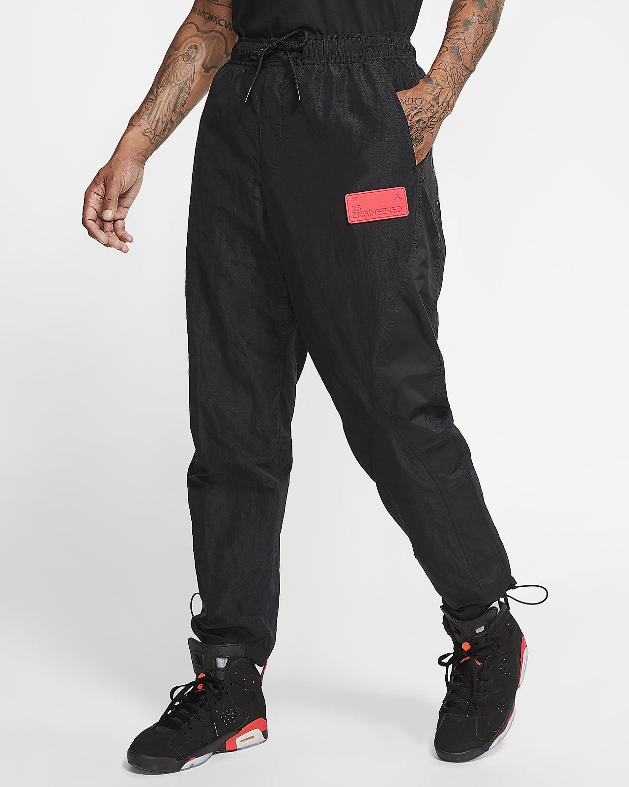 Convencional Derechos de autor Leer  Jordan 23 Engineered Men's Nylon Trousers. Nike SG