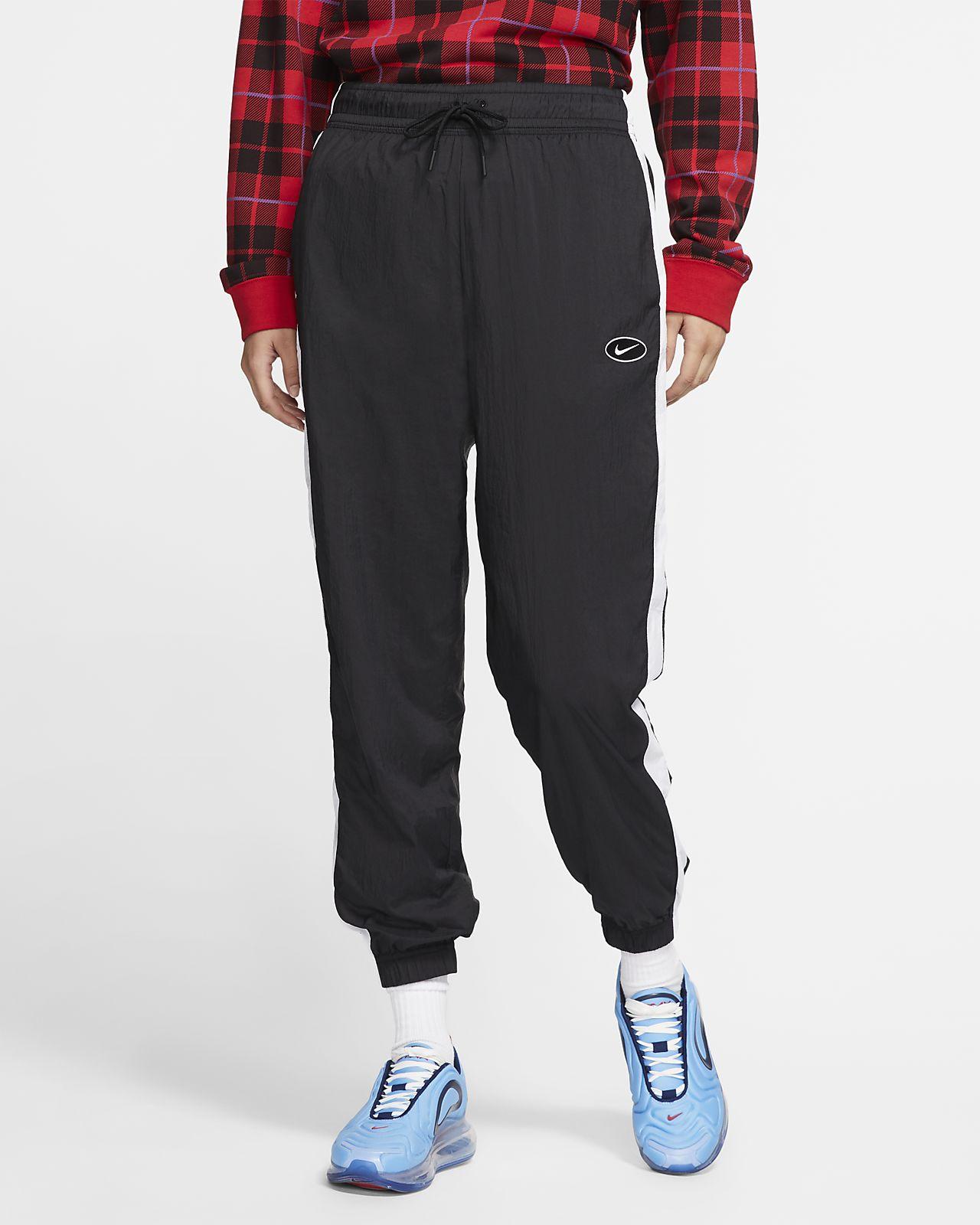 Nike Sportswear Pantalons de teixit Woven amb logotip Swoosh - Dona