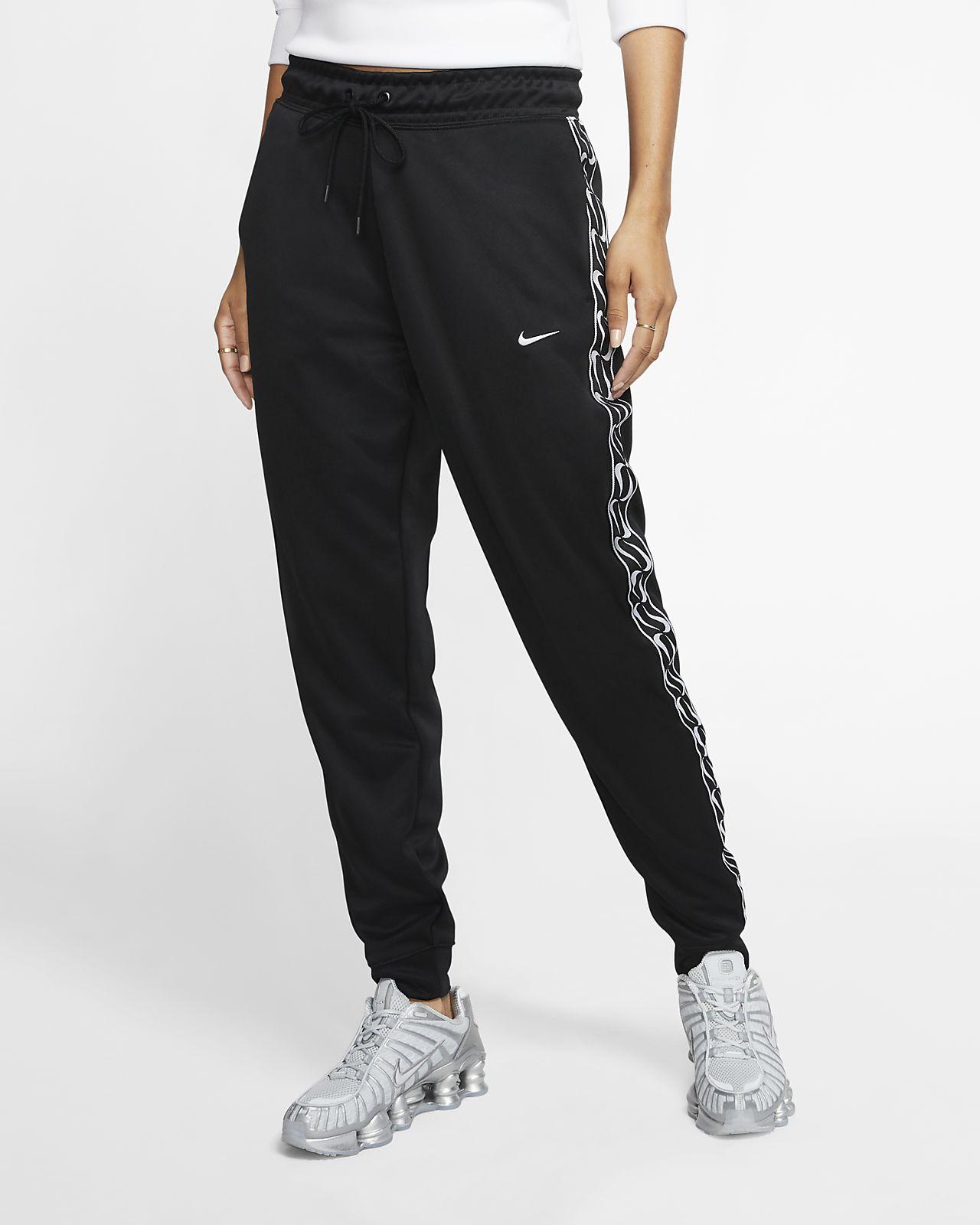 Dámské běžecké kalhoty Nike Sportswear s logem