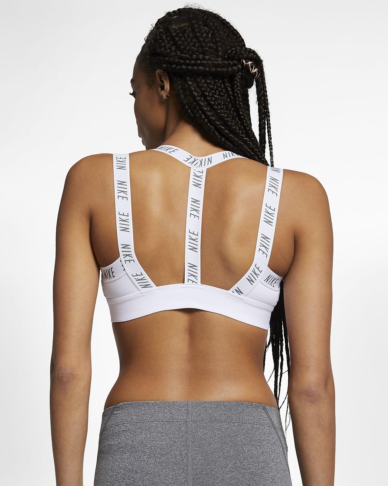 Nike Indy Logo Sport-BH mit leichtem Halt für Damen