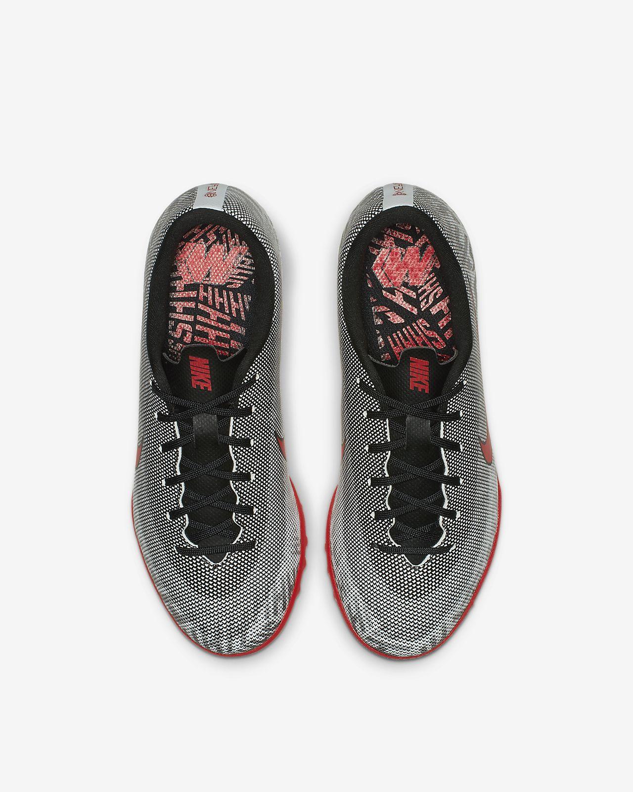 ... Calzado de fútbol para terreno artificial para niños talla  pequeña grande Nike Jr. Mercurial f13afe6c6ce