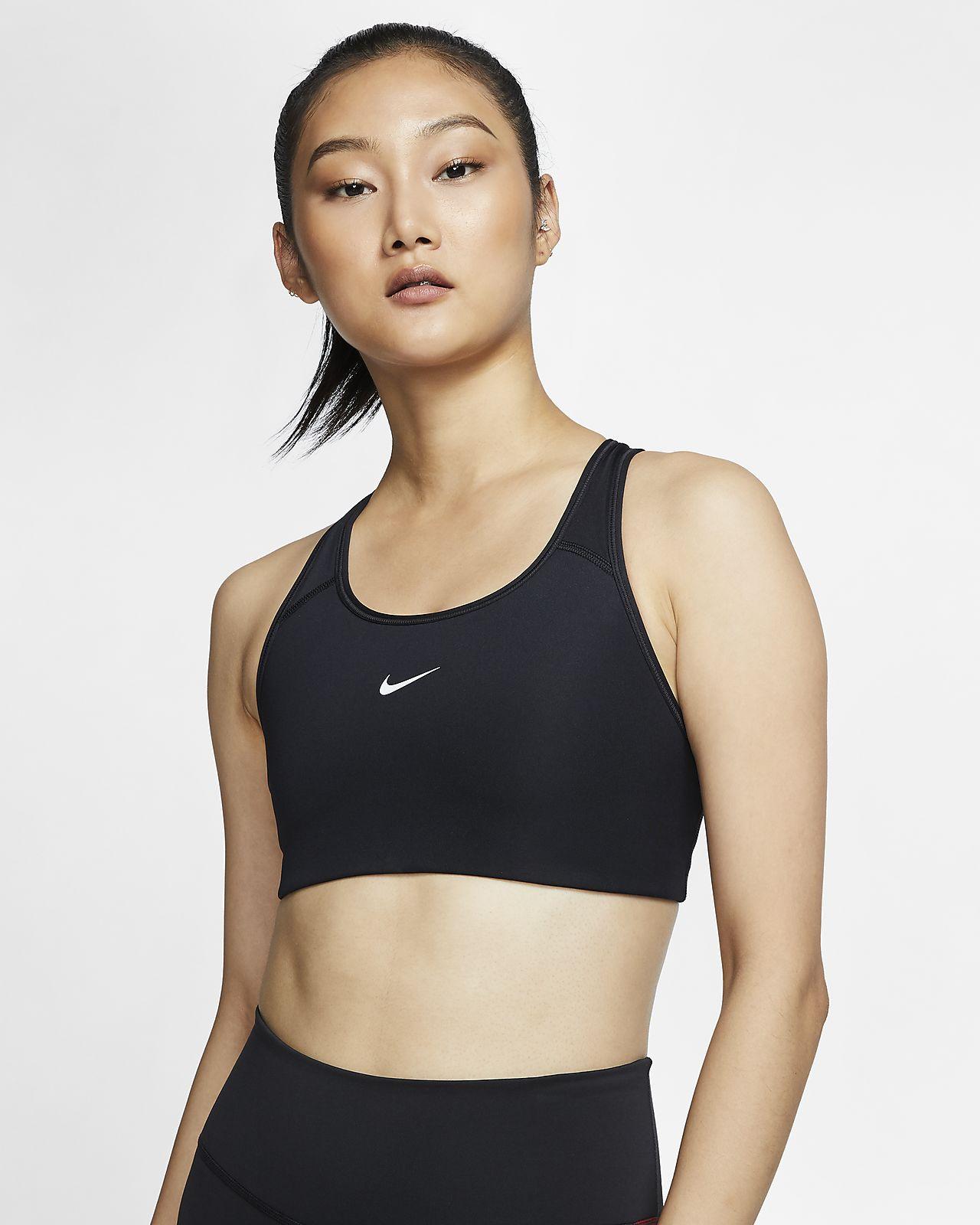 Medium støtte Nike Swoosh-sports-bh med indlæg i ét stykke til kvinder.