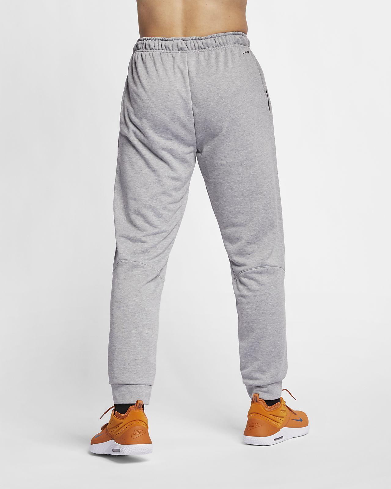 Pánské zúžené tréninkové kalhoty Nike Dri-FIT z flísu. Nike.com CZ bcb8756282