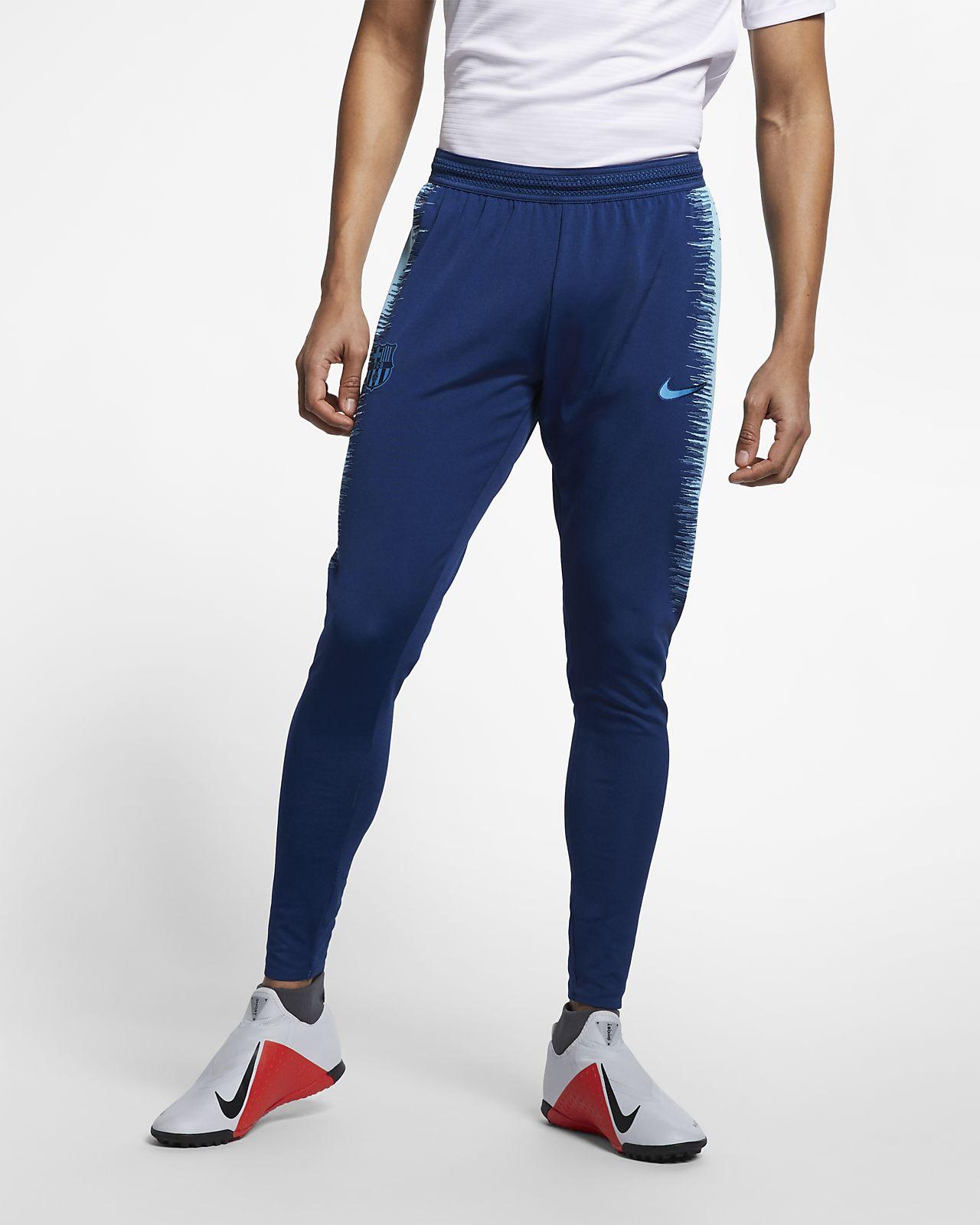 90129dc56bdec FC Barcelona VaporKnit Strike Men s Football Pants. Nike.com GB