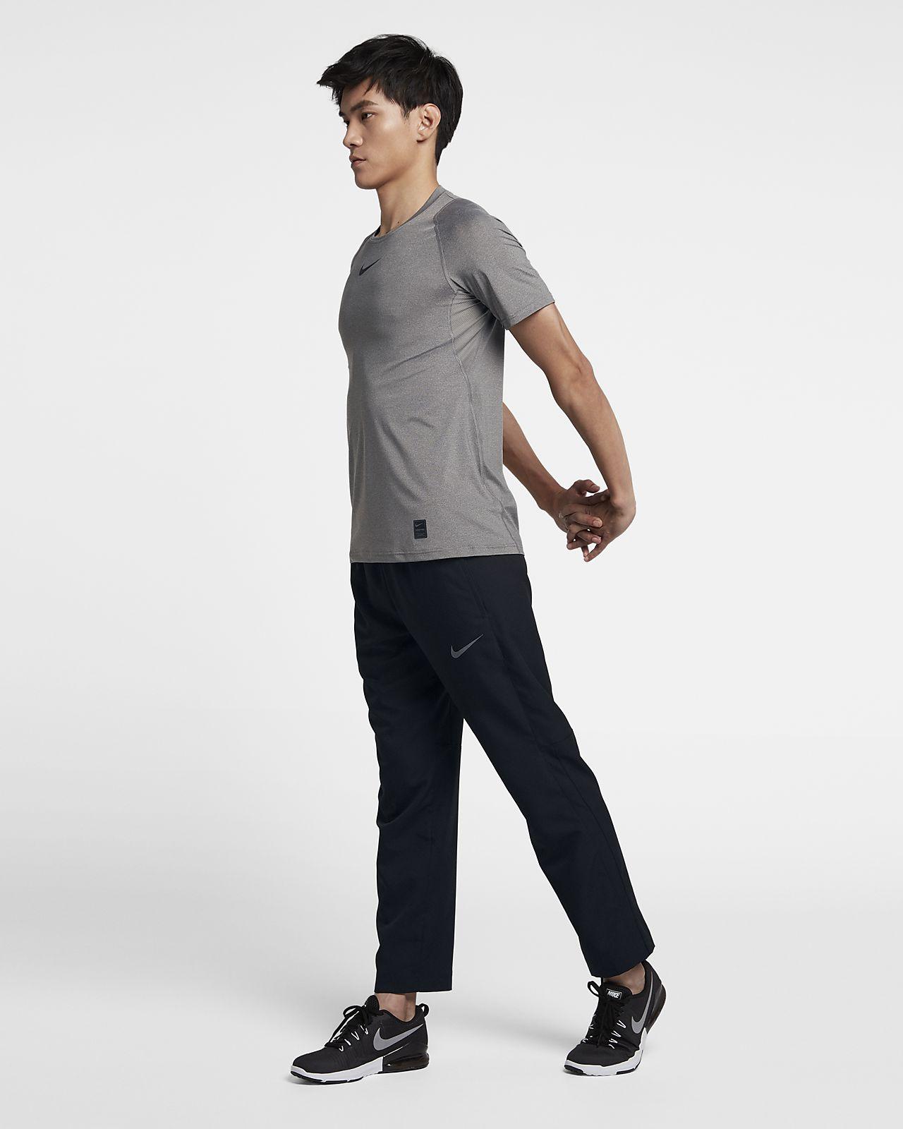 Pantaloni da training woven Nike Dri FIT Uomo. Nike IT