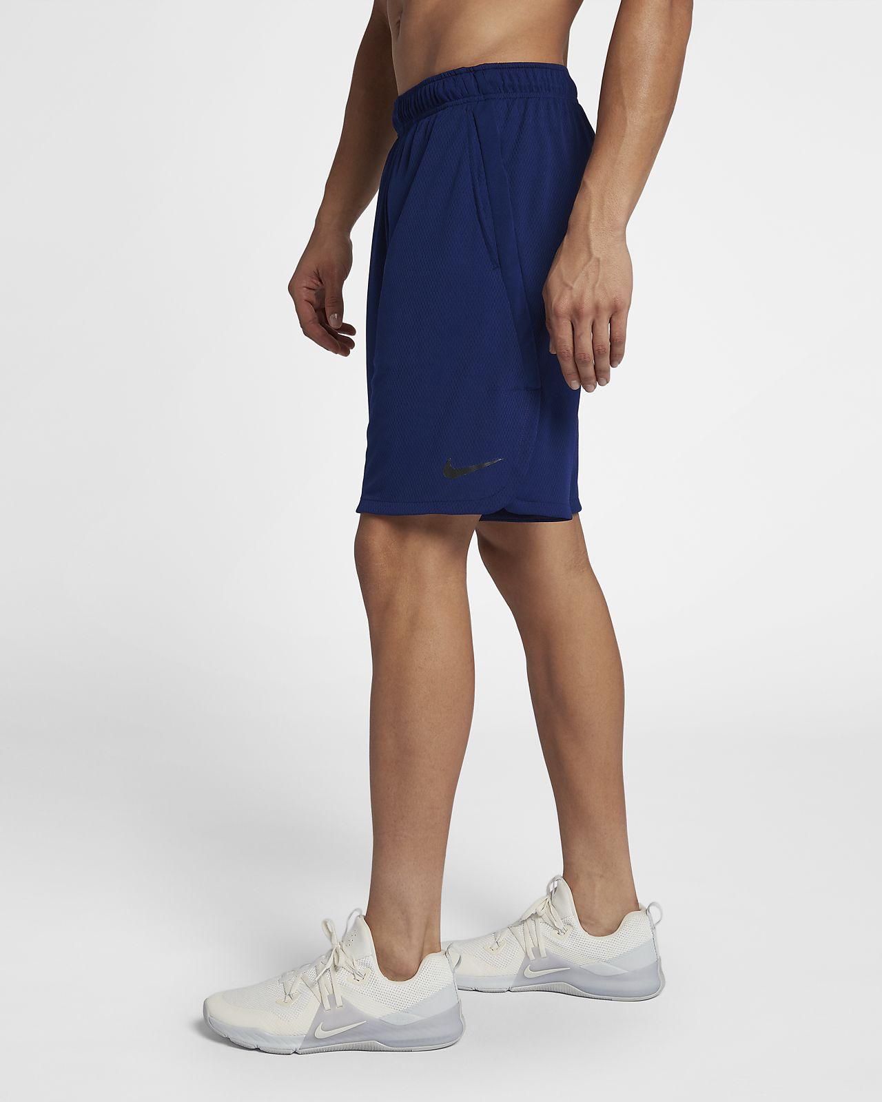 ... Nike Dri-FIT Pantalón corto de entrenamiento de 23 cm de tejido Woven -  Hombre 9f762eaf327