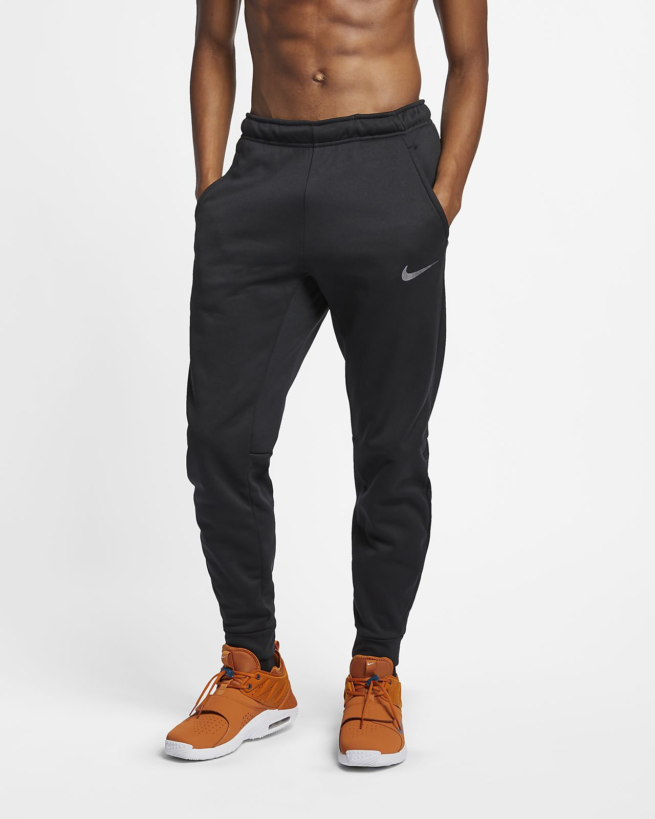 combate Masacre Júnior  Nike Therma Men's Tapered Training Trousers. Nike SI