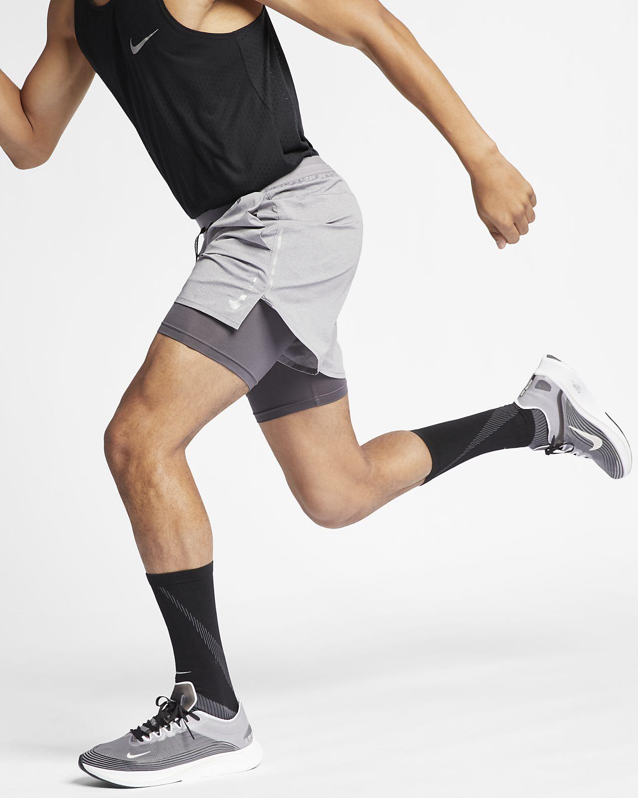 Calções de running 2 em 1 de 13cm Nike Flex Stride para homem