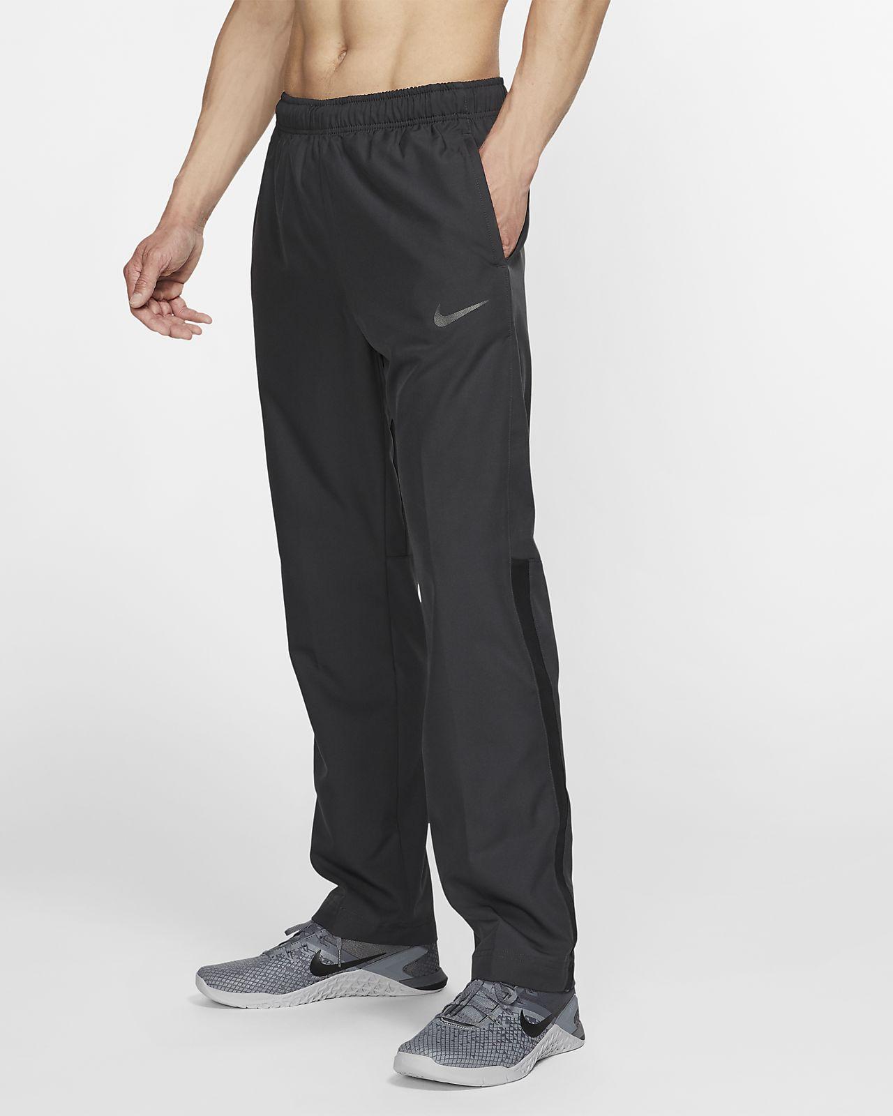 cómo hacer pedidos disfrute del envío de cortesía zapatos clasicos Pantalones tejidos de entrenamiento para hombre Nike Dri-FIT