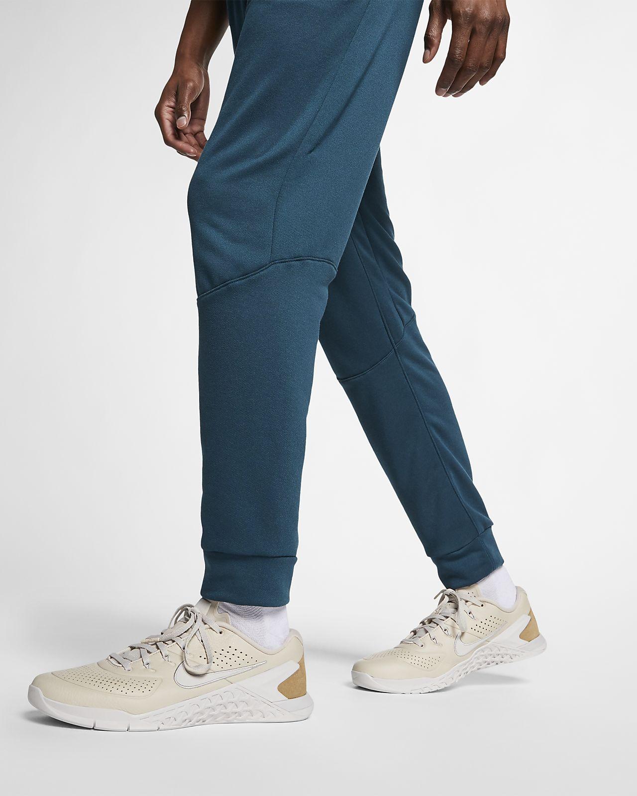 Nike Dri-FIT avsmalnet treningsbukse i fleece til herre