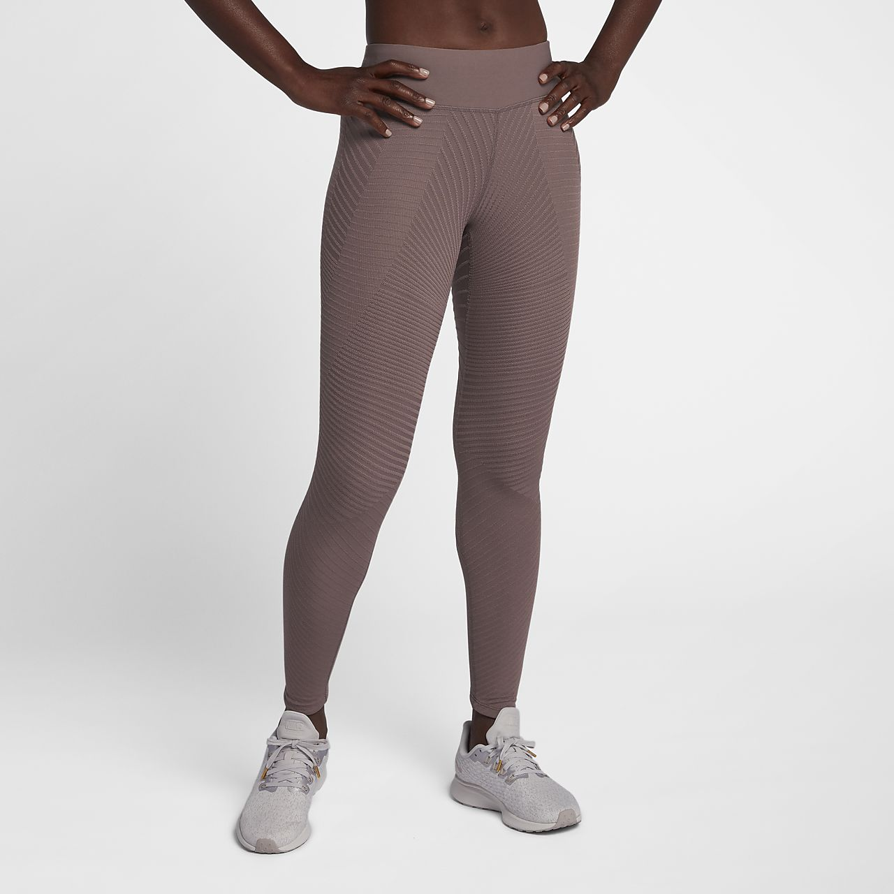 Nike Epic Lux Women s Texture Mid-Rise Running Tights. Nike.com LU 01c0bbe0c