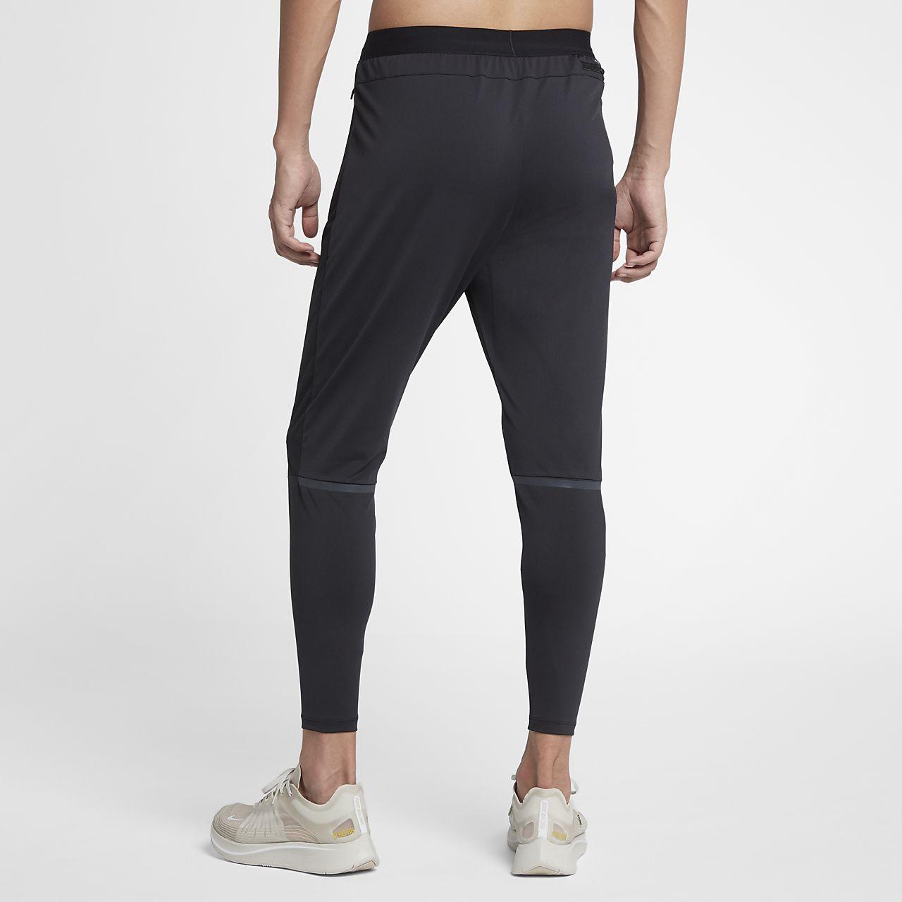 Pánské běžecké kalhoty Nike Shield Swift. Nike.com CZ 7ad054c387