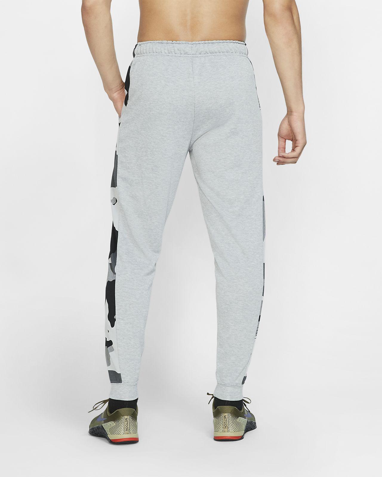 240e7cae43f5f ... Pantalon de training fuselé en tissu Fleece Nike Dri-FIT pour Homme