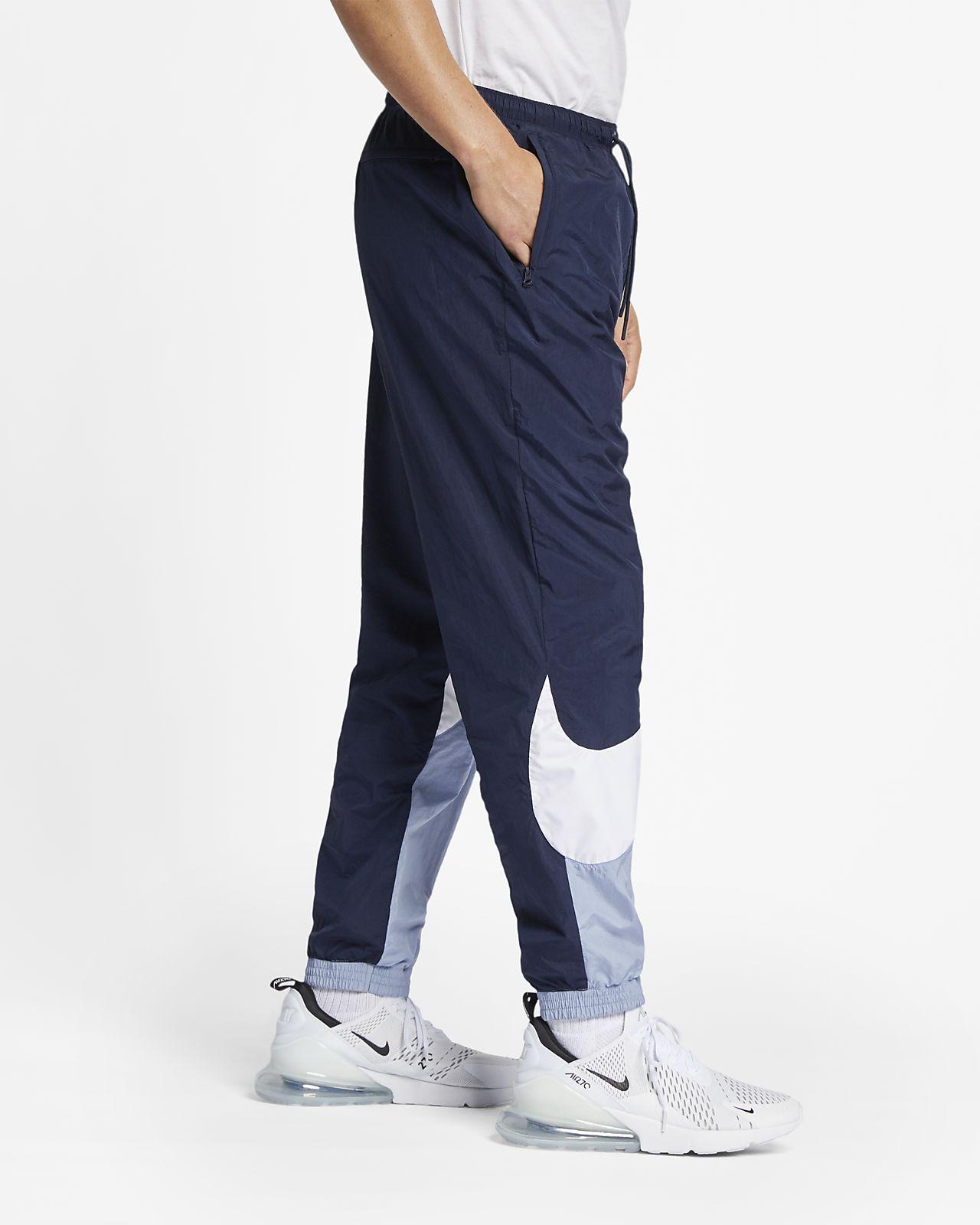 Tkané kalhoty Nike Sportswear