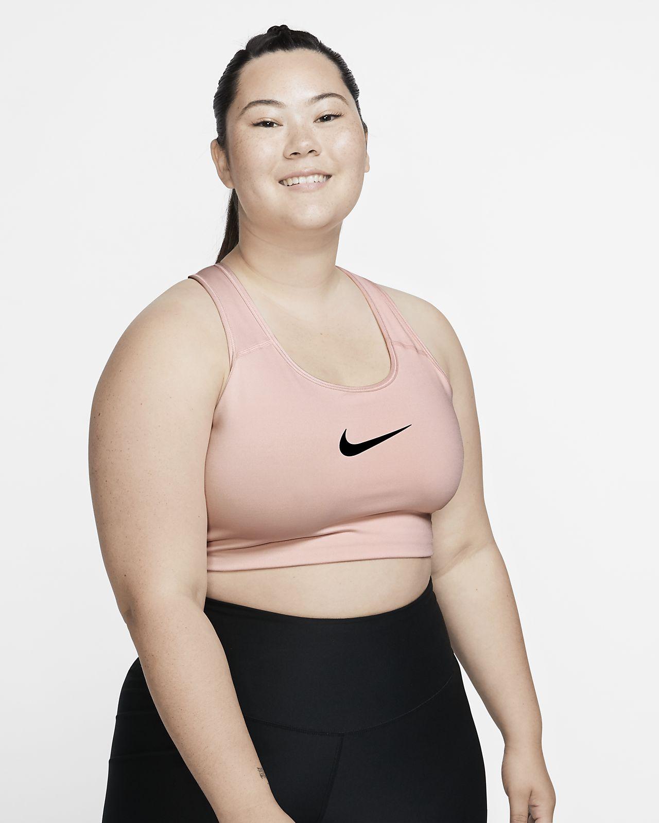 Damski stanik sportowy zapewniający średnie wsparcie z logo Swoosh Nike (duże rozmiary)