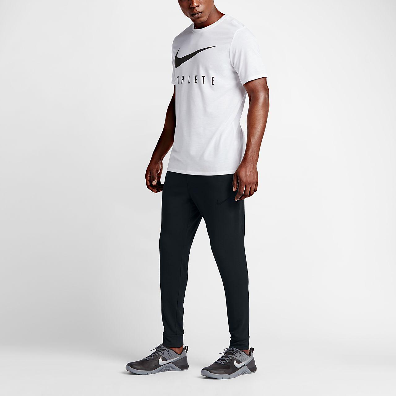 a36fca00ff8b6 Pantalones de entrenamiento de vellón para hombre Nike Dri-FIT. Nike ...