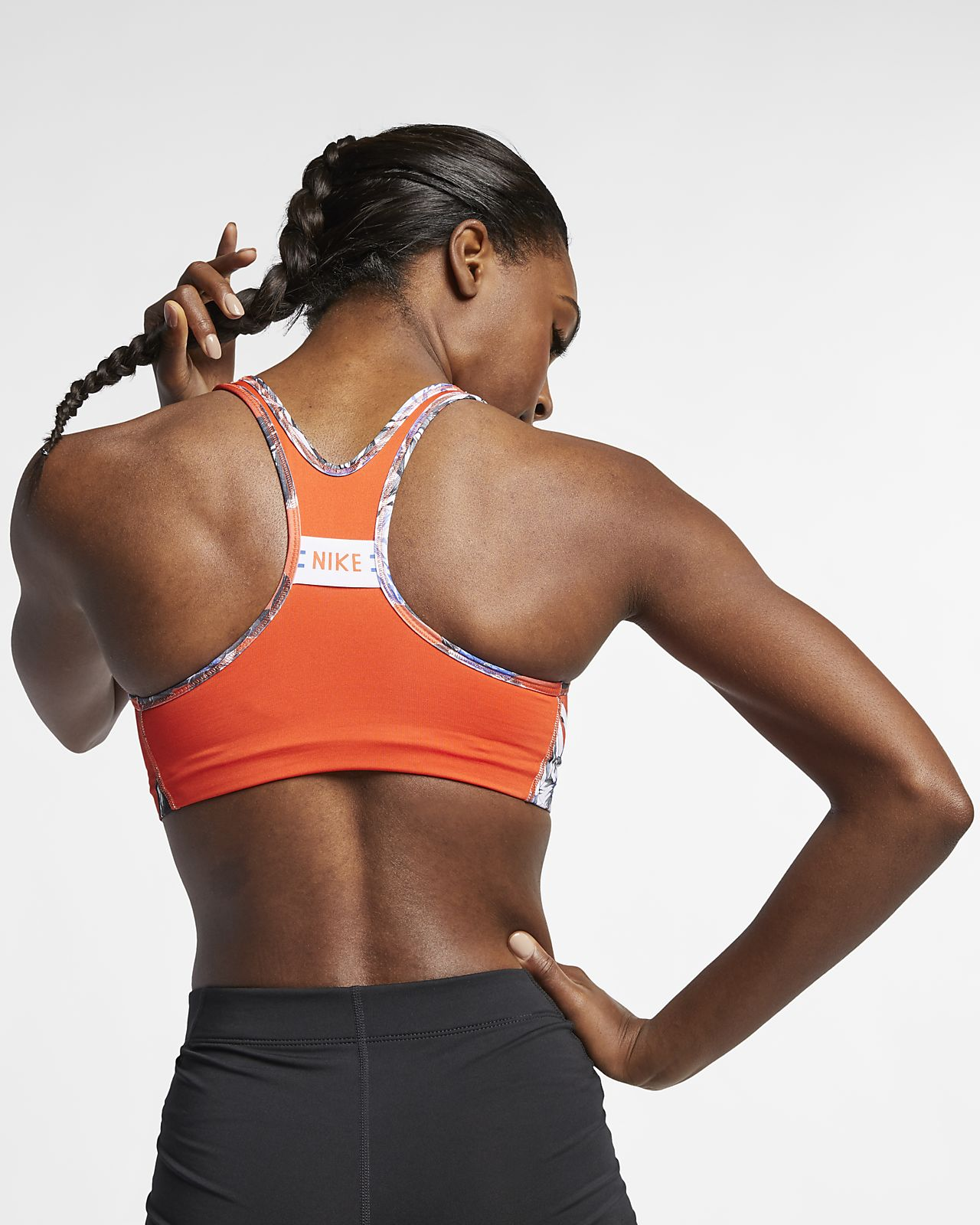 50503284edf Nike Swoosh Women s Medium Support Floral Sports Bra. Nike.com