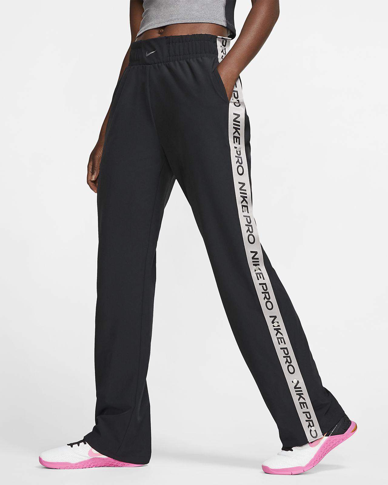 Byxor med knäppning längs benen Nike Pro för kvinnor