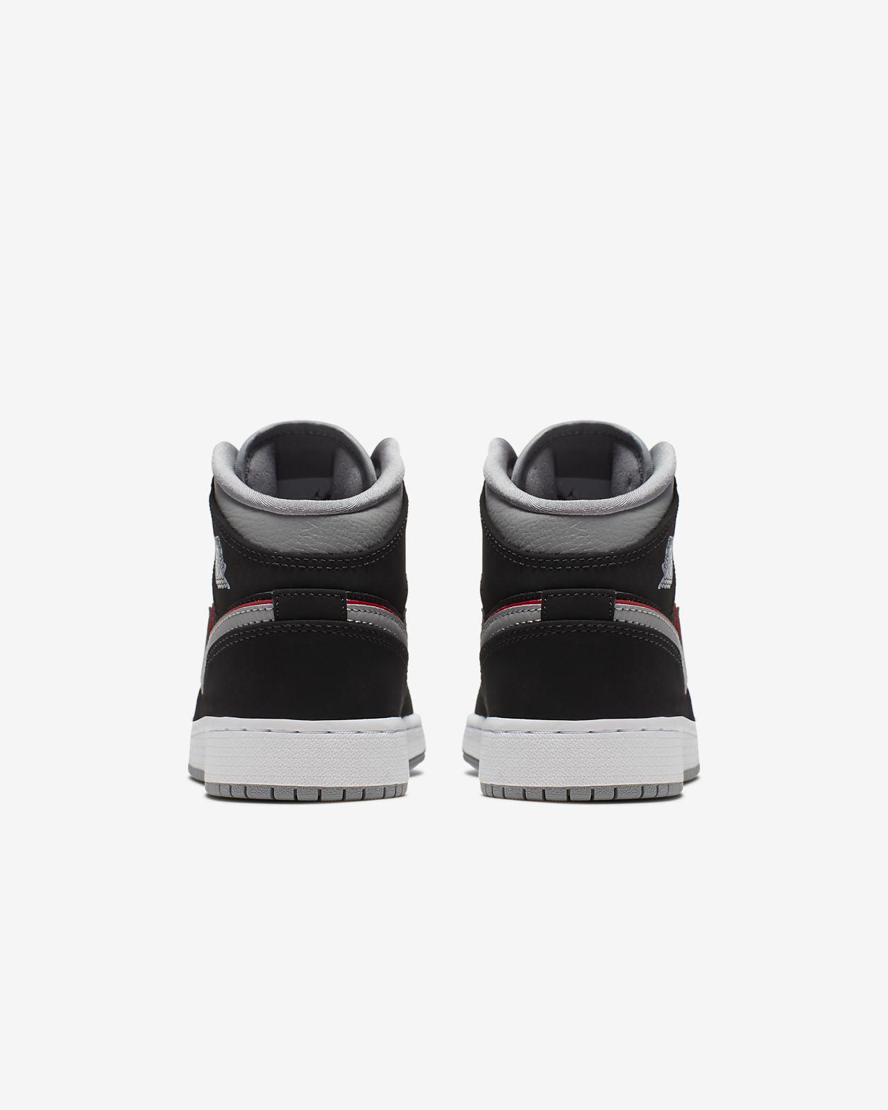 c031019c7b077c Air Jordan 1 Mid Big Kids  Shoe. Nike.com