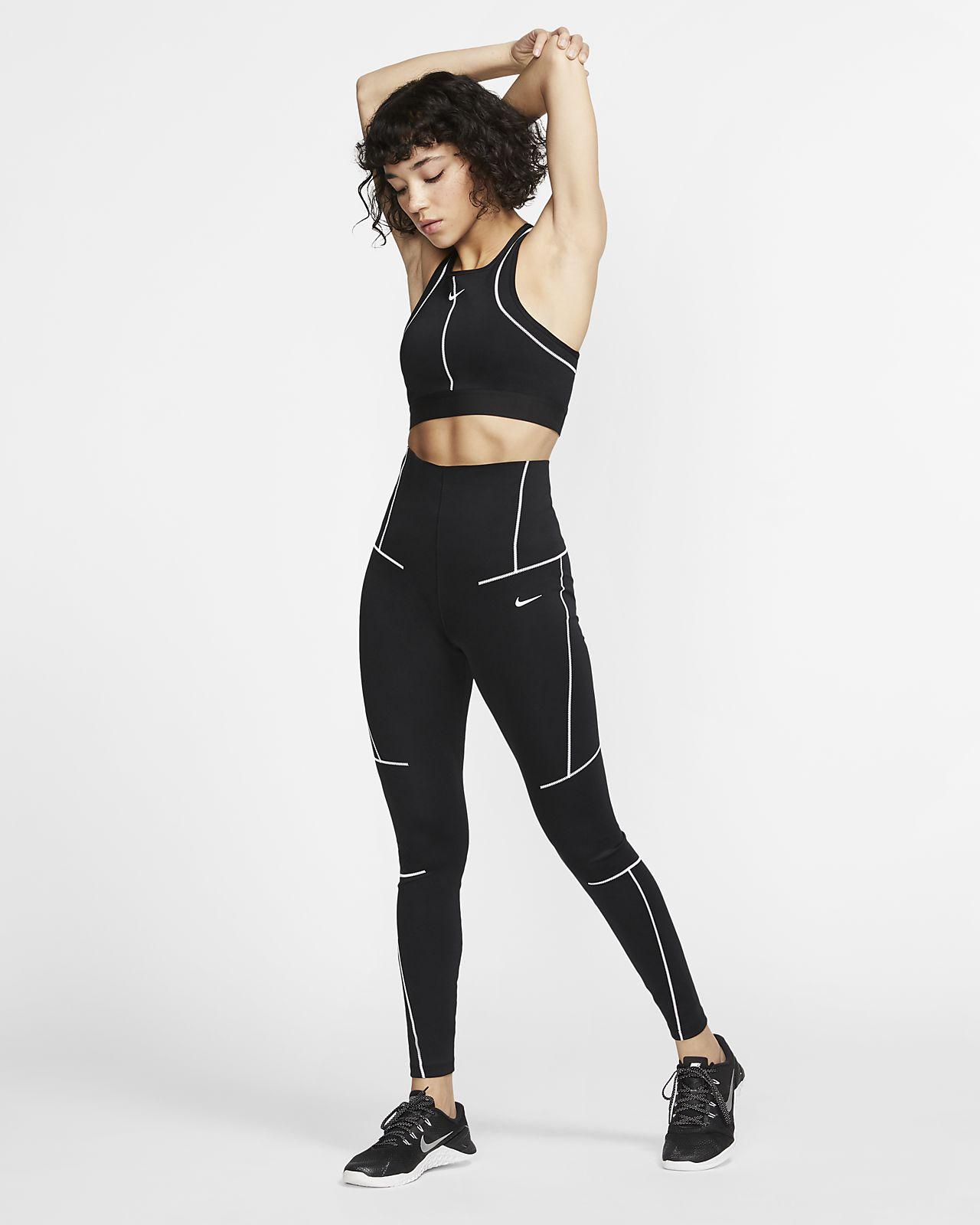 6beaeb720 Sujetador deportivo de sujeción media para mujer Nike Swoosh. Nike ...