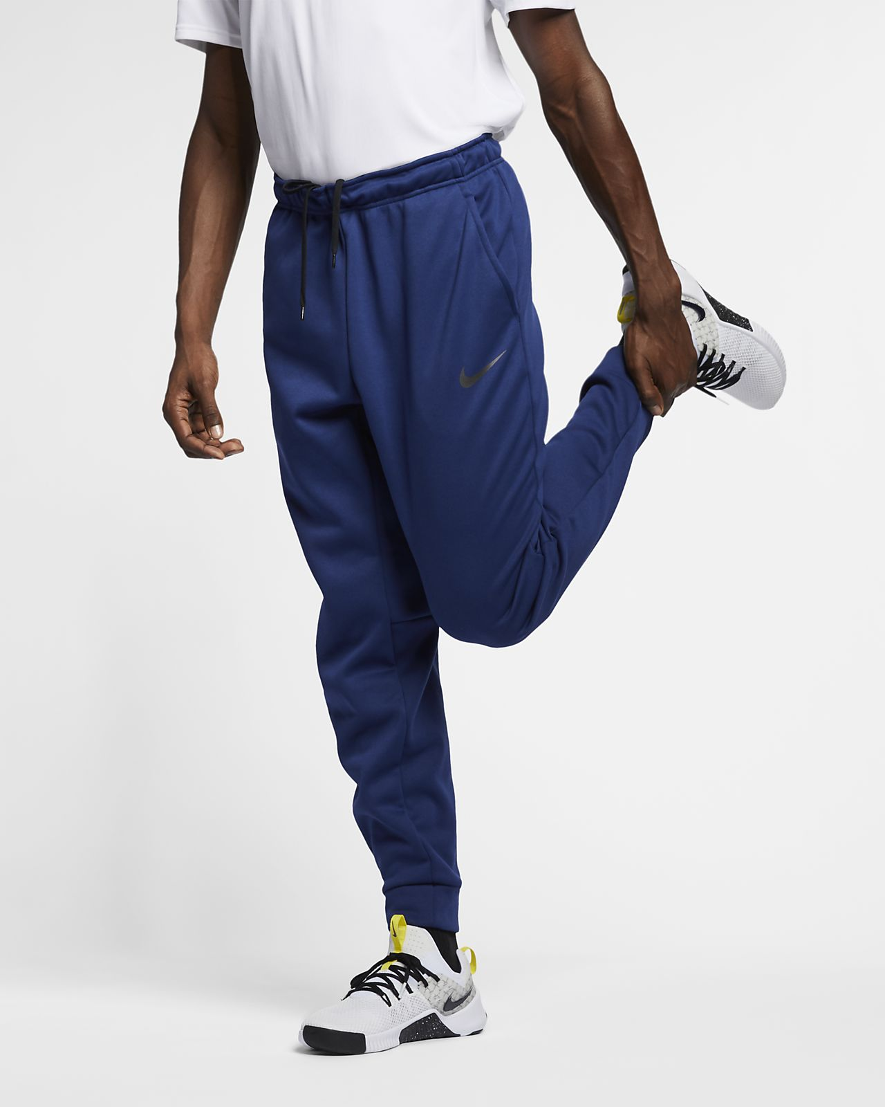 2ae9af21c Pánské zúžené tréninkové tepláky Nike Therma. Nike.com CZ