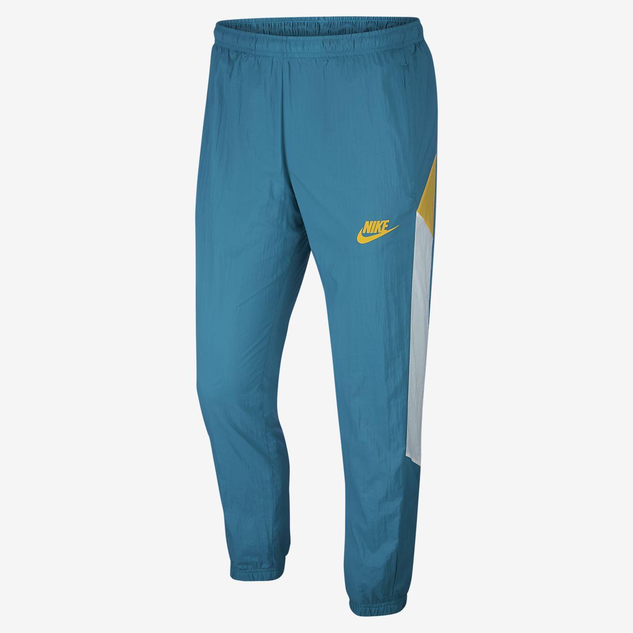 Nike Sportswear Pantalons de teixit Woven - Home