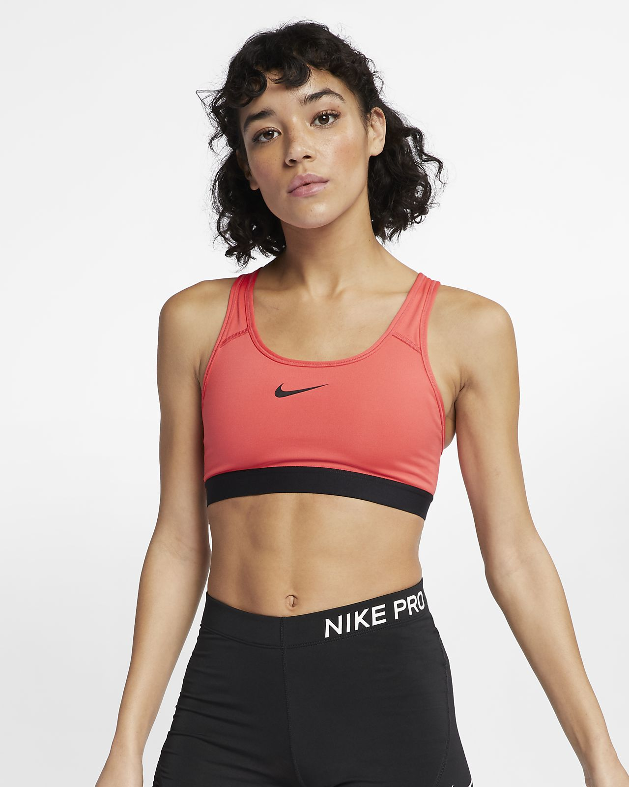 ab0ee6c074 Nike Classic Padded Women s Medium-Support Sports Bra. Nike.com