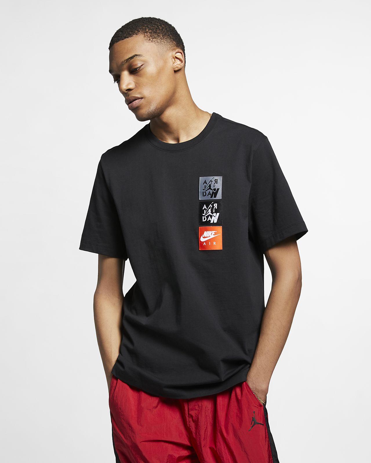 96828e7714d4 Jordan Legacy AJ4 Woven Labels Men s T-Shirt. Nike.com