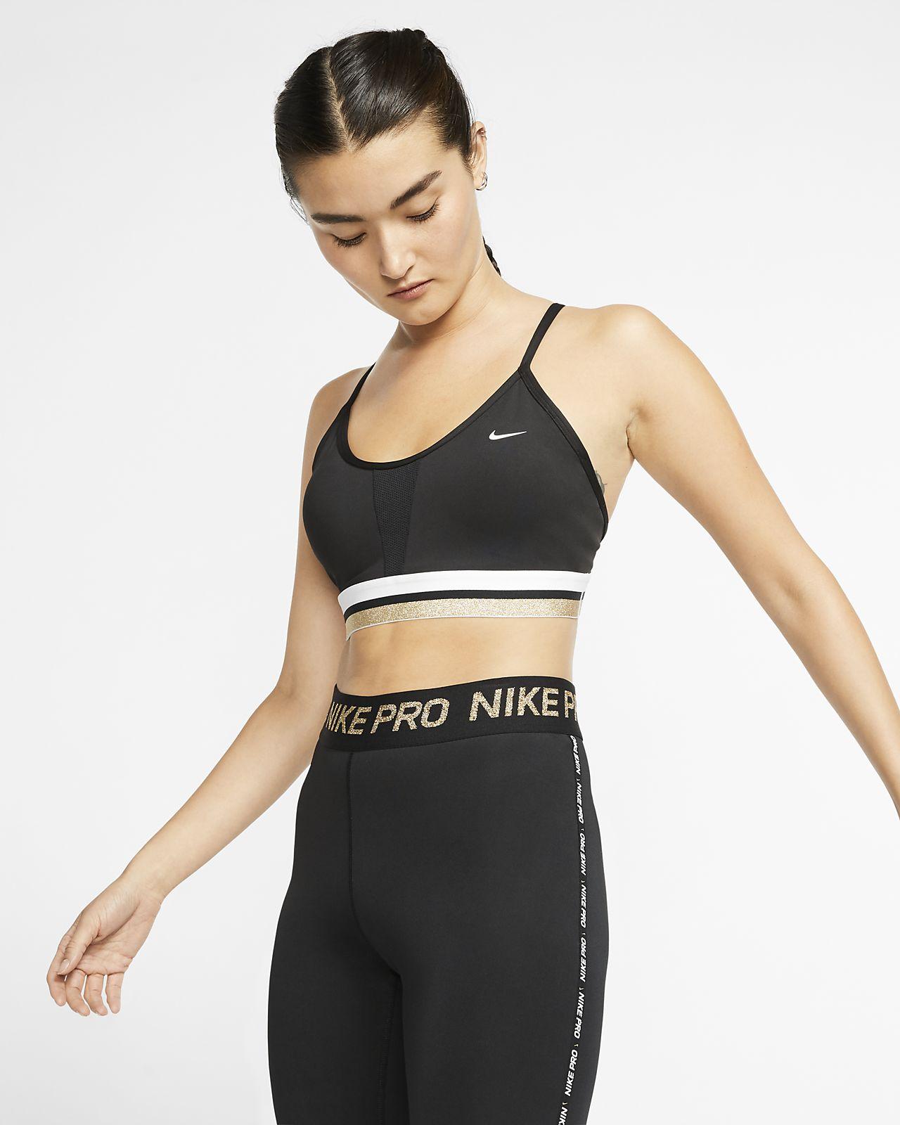 Sportovní podprsenka Nike Indy Icon Clash s lehkou oporou