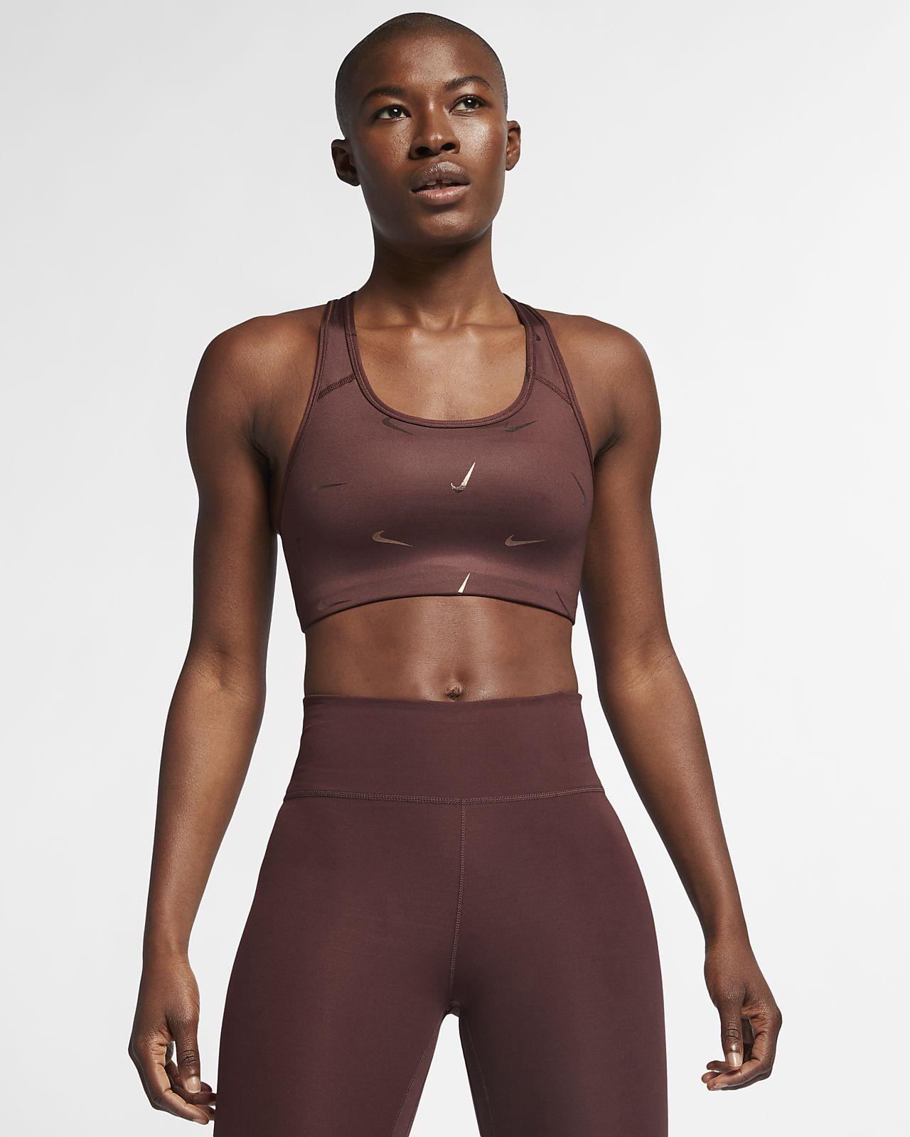 Mönstrad sport-BH med mediumstöd Nike Swoosh för kvinnor