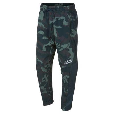 Joggingbyxor Nike Sportswear NSW i vävt tyg med kamouflagemönster för män