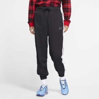 Pantaloni in woven con Swoosh Nike Sportswear - Donna