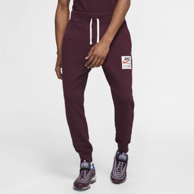 Pánské běžecké kalhoty s potiskem Nike Sportswear Club