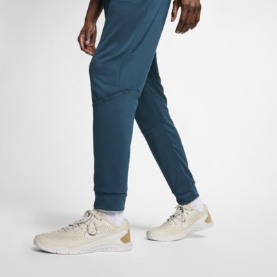 Nike Dri-FIT Pantalons de teixit Fleece cenyits d'entrenament - Home