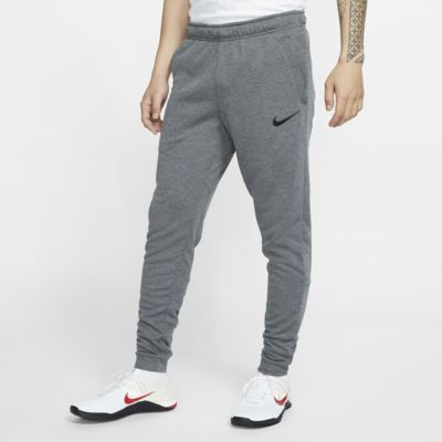 Calças de treino de lã cardada afuniladas Nike Dri-FIT para homem