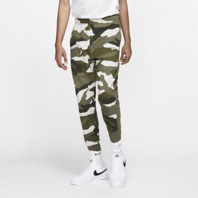 Kamouflagemönstrade joggingbyxor i frotté Nike Sportswear Club för män