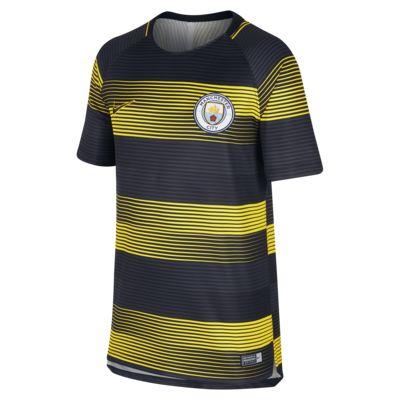Fotbalové tričko Nike Dri-FIT Manchester City Squad s krátkým rukávem a grafickým motivem pro větší děti