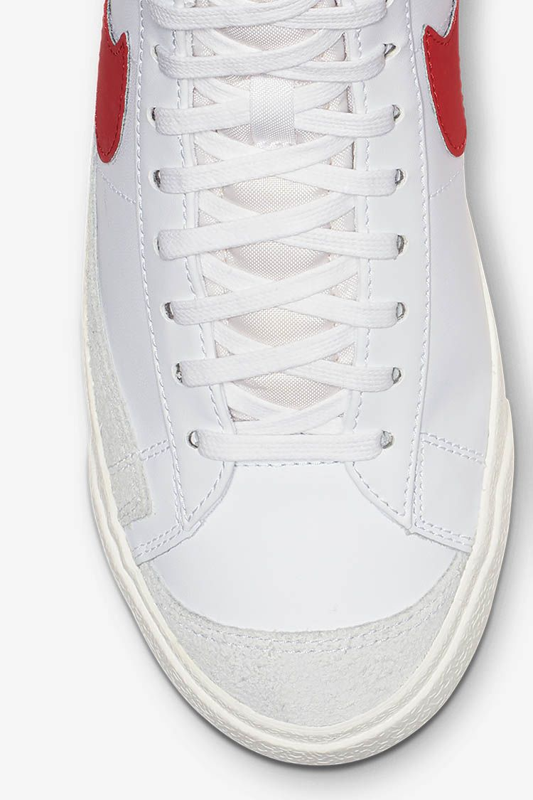 00c7201fa9df The iconic silhouette arrives in a white leather upper and red Nike Swoosh