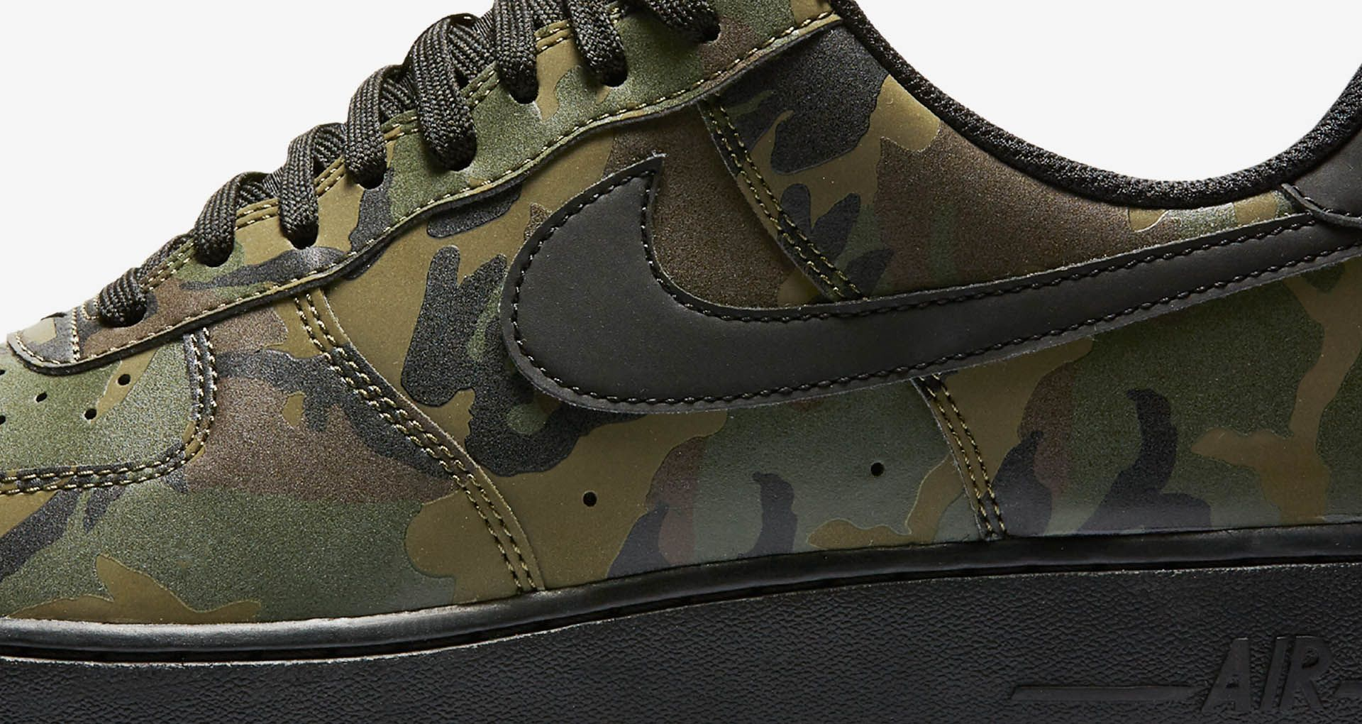 ee67a09ad80e Reflective detailing throughout the upper adds a shine once exposed to  light. A classic Air Force 1 sole in black completes the camo design.
