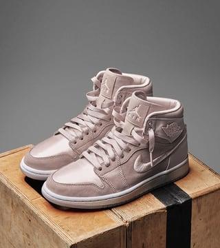 white and peach jordans