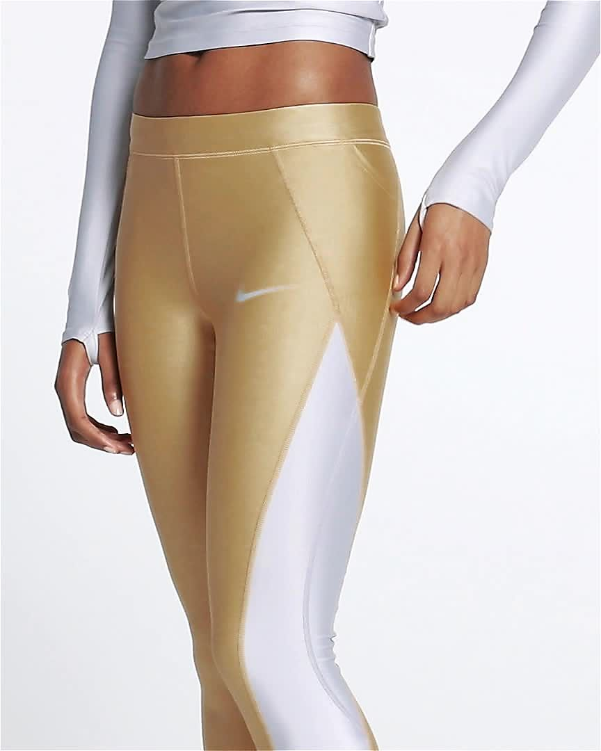 Nike Speed Women s 7 8 Mid-Rise Metallic Running Tights. Nike.com 73c81554b